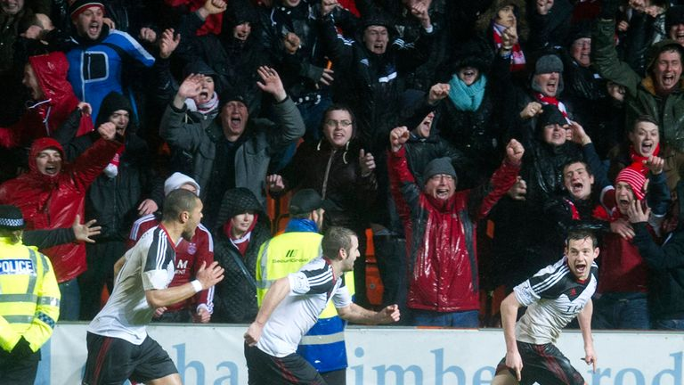 Peter Pawlett celebrates his last-gasp winner at Tannadice