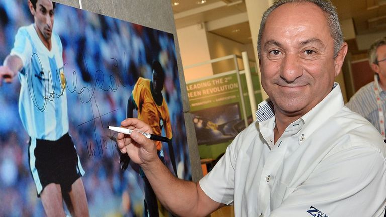 Ossie Ardiles signs a photograph of himself last year