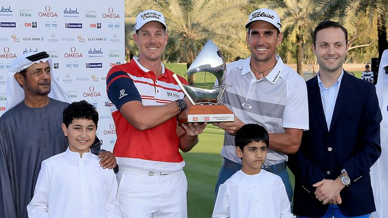 Joint-winners in Dubai's Champions Challenge event: Henrik Stenson (l) and Rafa Cabrera-Bello with the trophy