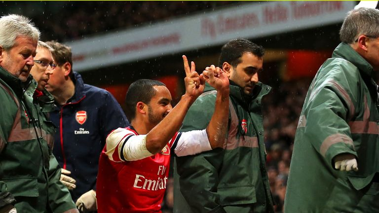 Theo Walcott: Arsenal winger is stretchered off against Tottenham