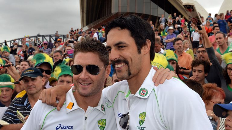 Michael Clarke and Mitchell Johnson pose for photos as thousands turn up to celebrate Australia's Ashes victory