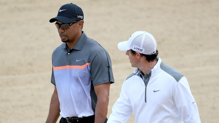 Rory McIlroy (R) outshone Tiger Woods on the opening day in Dubai