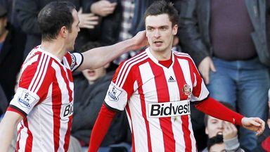 John O'Shea (left) celebrates Sunderland's first goal at Fulham with Adam Johnson