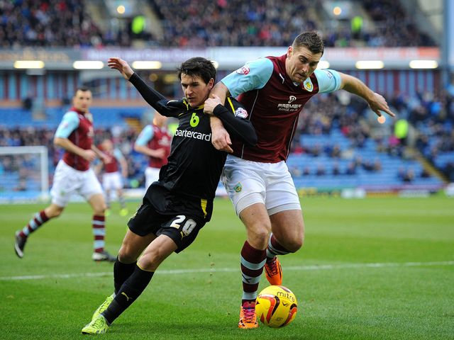 Sam Vokes powers away from Kieran Lee