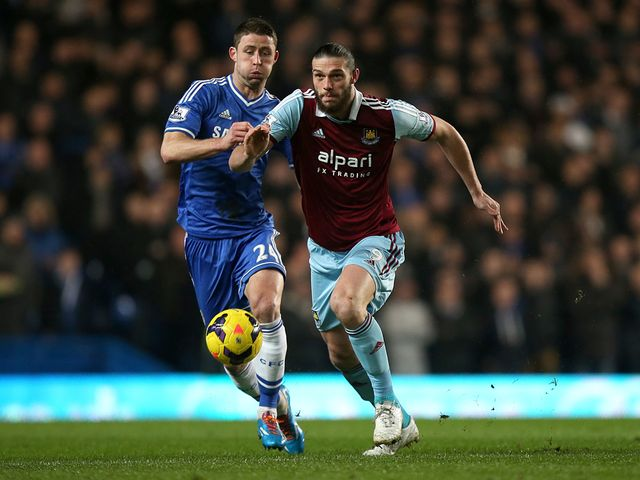 Gary Cahill and Andy Carroll compete for the ball