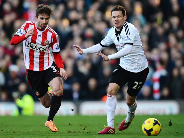 Fabio Borini of Sunderland and Sascha Riether do battle