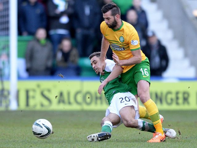 Joe Ledley is tackled by Tom Taiwo