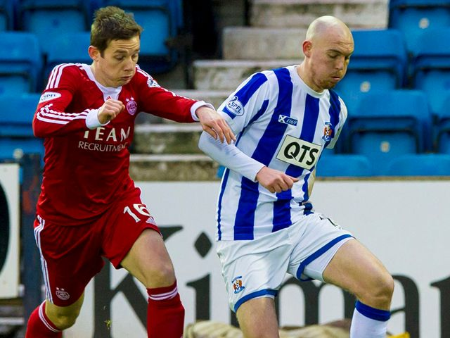 Kilmarnock's Sean Clohessy is tracked by Peter Pawlett