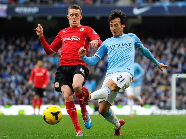 David Silva knocks the ball away from Craig Noone