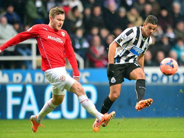 Newcastle's Hatem Ben Arfa (r) and Cardiff's Aron Gunnarson