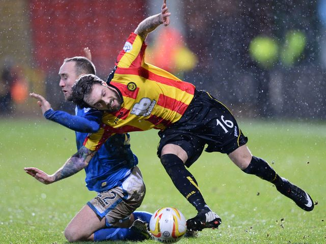 Jordan McMillan attempts to break away from Lee Croft