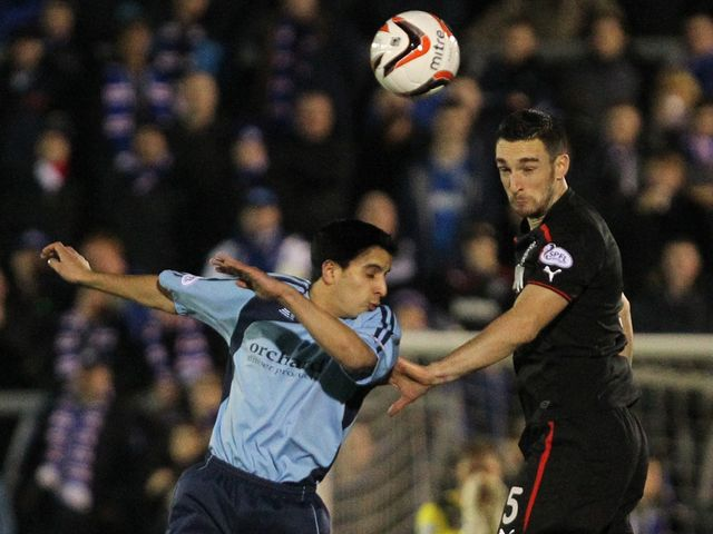 Rangers' Lee Wallace challenges Forfar's Omar Kader
