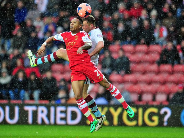 Nathaniel Clyne and Scott Arfield go for a high ball