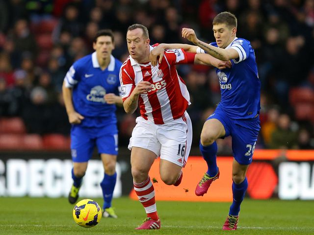 Charlie Adam tries to escape from John Stones