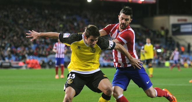 David Villa tries to keep the ball in play