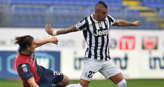 Juventus midfielder Arturo Vidal is tackled