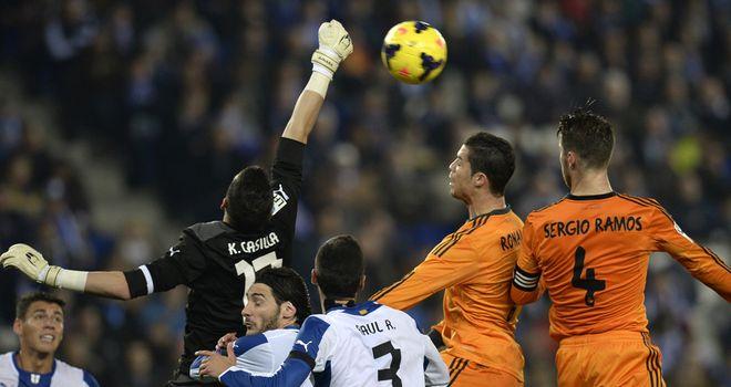 Cristiano Ronaldo vies with Espanyol's goalkeeper