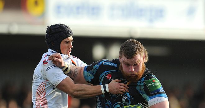 Exeter's Lloyd Fairbrother is tackled by Matthew Morgan