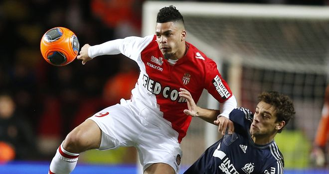 Emmanuel Riviere beats Lucas Mendes to the ball