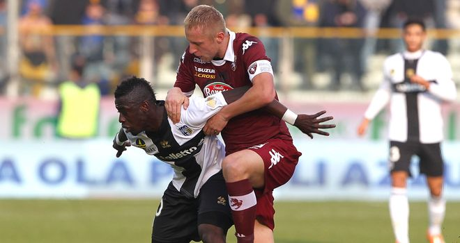 Acquah is put under pressure by Glik