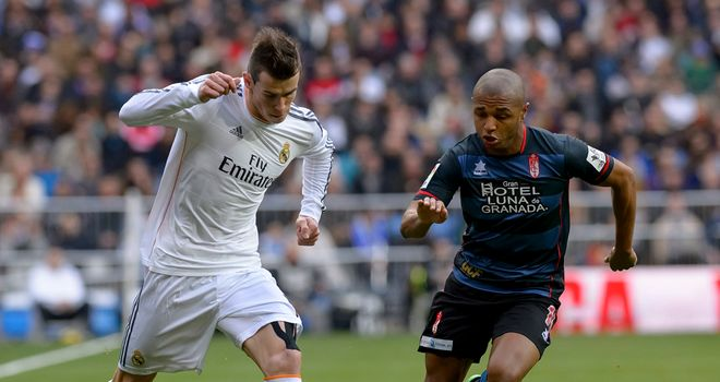 Gareth Bale takes on Pape Diakhate