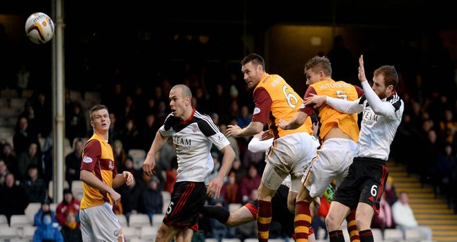 Stephen McManus heads Motherwell in front at Fir Park