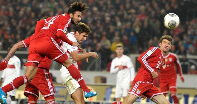 Bayern Munich's Claudio Pizarro scores with a header