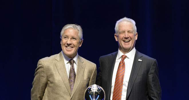 Pete Carroll and John Fox all smiles before Super Bowl