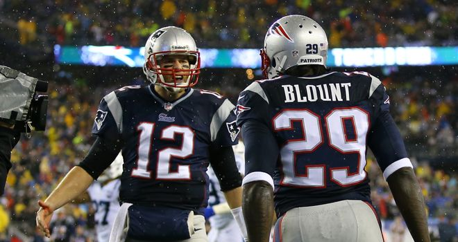 LeGarrette Blount of the New England Patriots celebrates with teammate Tom Brady