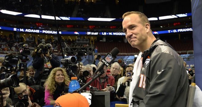 Denver Broncos quarterback Peyton Manning speaks to the press during Media Day