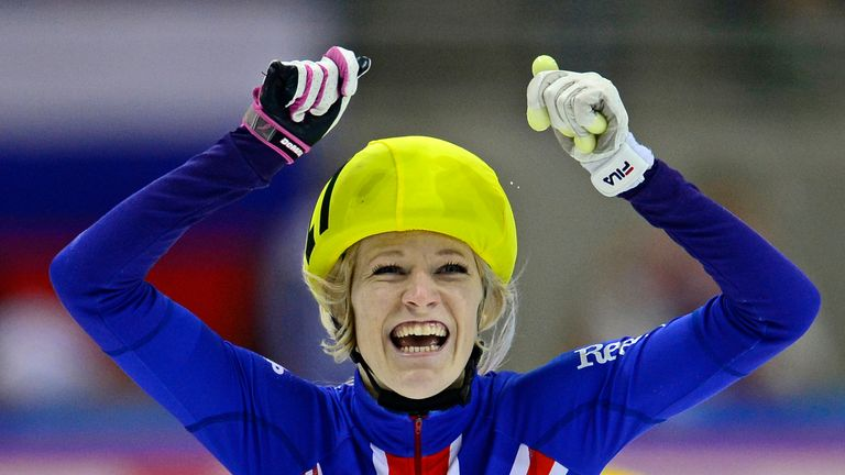 Elise Christie: Celebrates after winning the 1000m in Dresden
