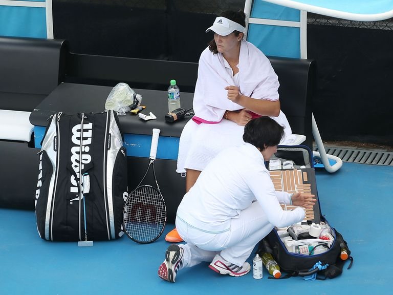 Laura Robson receives treatment on her wrist before withdrawing in Hobart