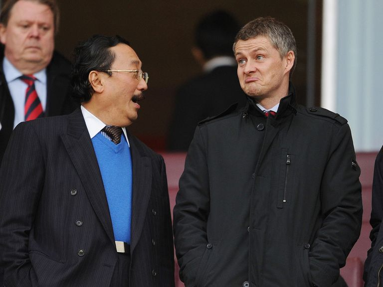 Ole Gunnar Solskjaer (right) could be set for a short stay in Wales
