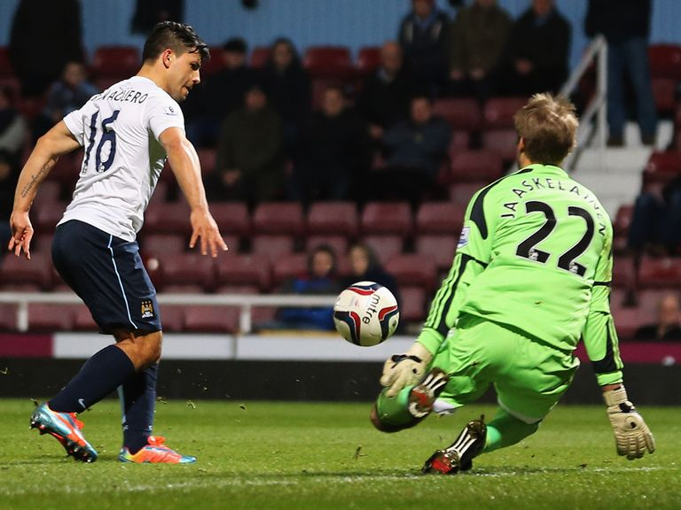 Sergio Aguero knocks in his goal at West Ham on Tuesday night