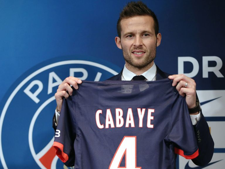 Yohan Cabaye poses with a shirt after signing for PSG