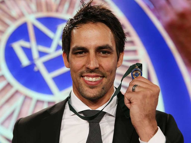 Mitchell Johnson all smiles as he holds the Allan Border Medal