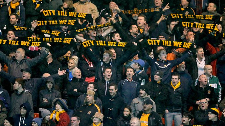 Hull City fans: Hold up their protest scarfs