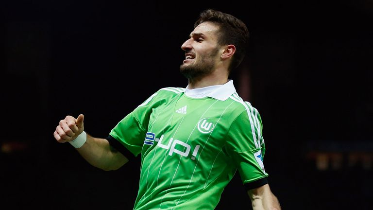 Daniel Caligiuri of Wolfsburg celebrates after scoring