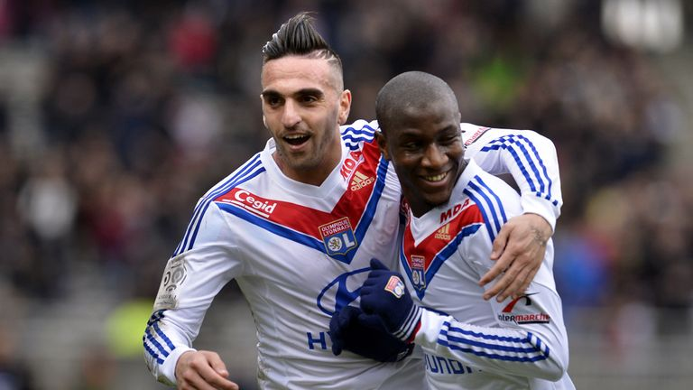 Lyon's Gueida Fofana is congratulated by Miguel Lopes