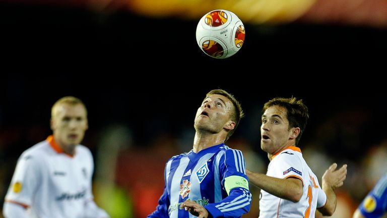 Andriy Yarmolenko (left) and Michel: Battle for the ball