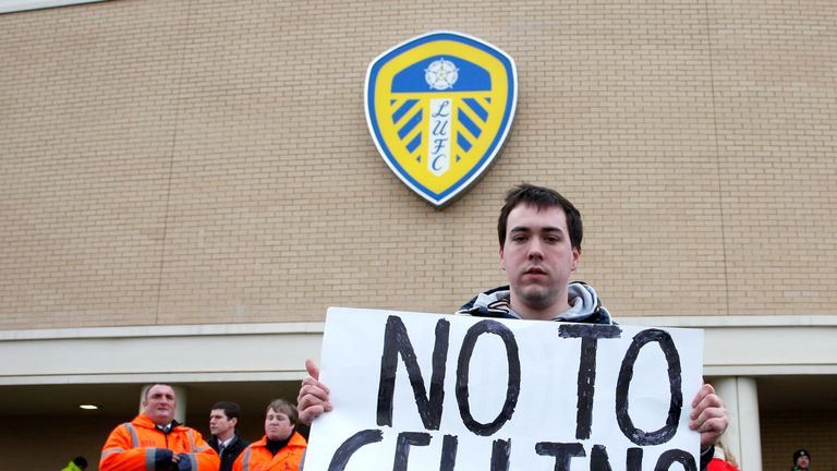 Uncertain times: a Leeds fan makes it clear that Massimo Cellino should not be allowed to buy at 75% stake in the club.