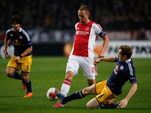 Siem De Jong of Ajax is tackled by Christian Schwegler of Salzburg