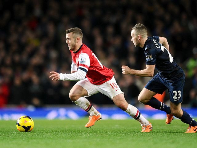 Jack Wilshere gets away from Tom Cleverley