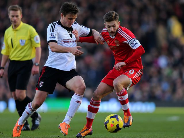 William Kvist (left) in action against Adam Lallana