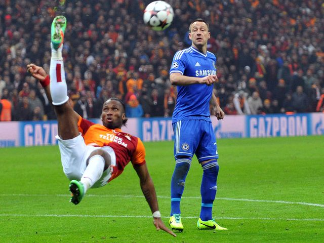 John Terry keeps an eye on Didier Drogba