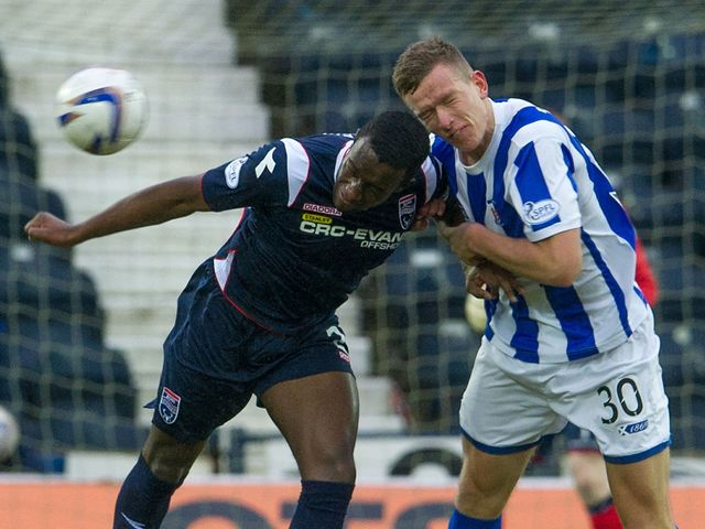 Kilmarnock's Lee Ashcroft battles with Jordan Slew