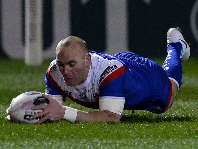 Luke Walsh goes in for a St Helens try