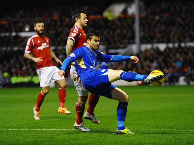 David Nugent knocks the ball away from Andy Reid