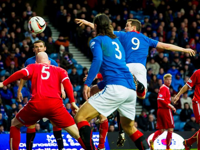 Rangers' Jon Daly scores the second goal of the game