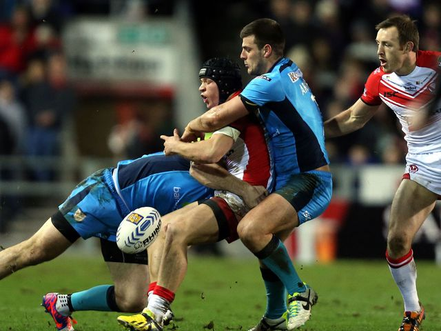 Jonny Lomax is tackled by Joe Arundel and Gareth Ellis